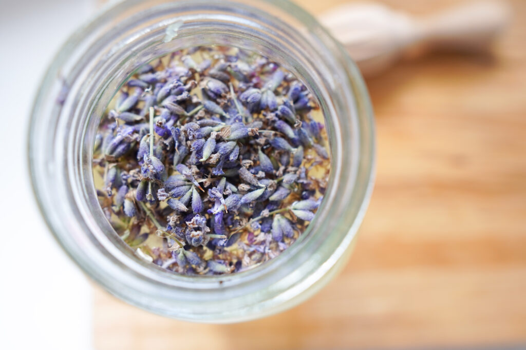 A birds eye view of lavender buds floating in a mason jar