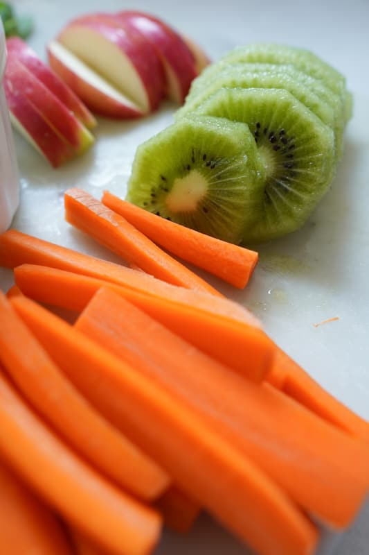 Sliced kiwi and carrots sliced into thin pieces